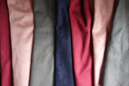 Pieces of artificial suede in pink, grey, blue, red