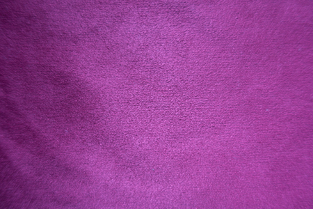 Violet artificial suede fabric surface from above