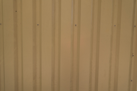 Beige plastic siding weatherboard on exterior wall