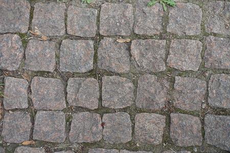 Close view of granite setts road pavement