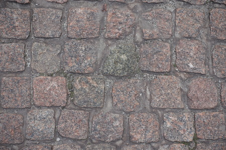 Rows of dusty granite setts from above