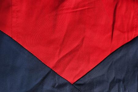Triangular seam between red and dark blue cotton