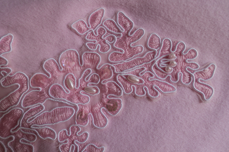 Sequins, pearl beads and embroidery on pink fabric