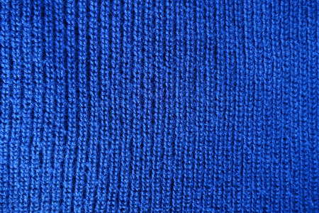 Handmade Blue Plain Knit Stitch Fabric From Above Stock Photo