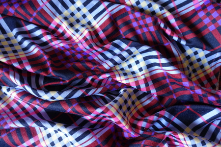 Rippled multicolored fabric in shades of violet Stock Photo