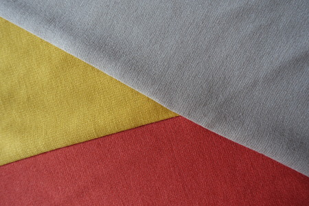 Beige, yellow and orange fabrics sewn together