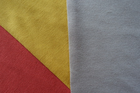 Golden yellow, orange and beige fabrics sewn together
