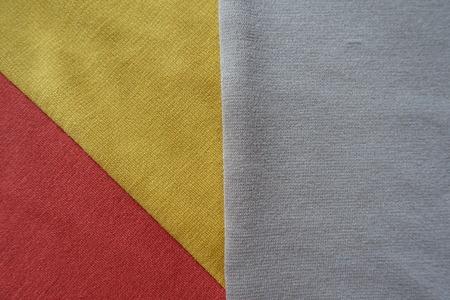 Orange, yellow and beige fabrics sewn together