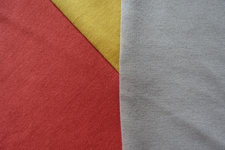 Yellow, orange and beige fabrics sewn together Stock Photo