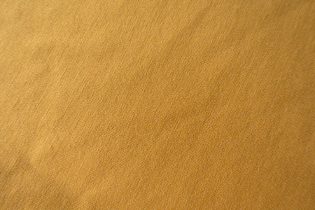Amber yellow simple jersey fabric from above