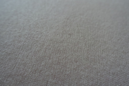 Plain cream white fluffy woollen knitted fabric