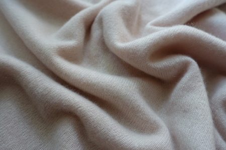 Rumpled simple white fluffy woolen knitted fabric