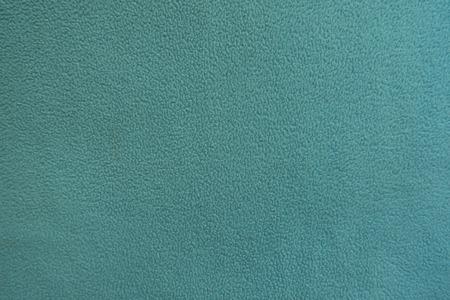 Mint green polar fleece fabric from above