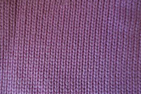 Handmade pink plain knit stitch fabric from above