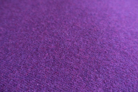Close view of woollen violet knit fabric Stockfoto