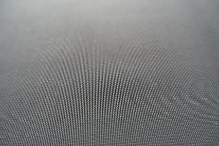 Macro of simple unprinted dark grey fabric