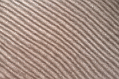 Jammed beige polyester fabric with sparkling fiber