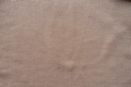 Peach colored plain polyester fabric from above