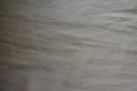 Surface of khaki artificial suede fabric from above Foto de archivo