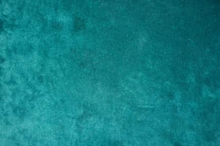 Top view of dark green velour fabric