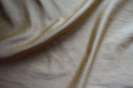 Greyish gold napped fabric in soft folds