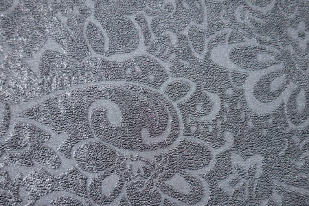 Slate fabric with relief floral pattern from above Imagens
