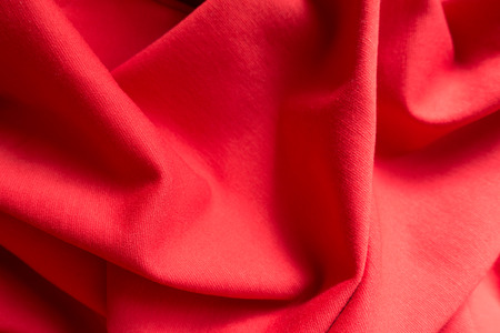 Bright red jersey fabric in soft folds