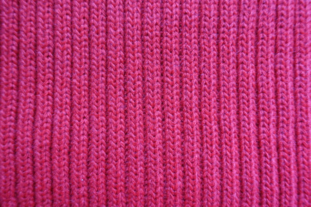 Rose red knitted fabric with ribs from above Stock Photo