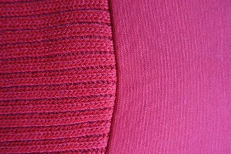 Two different bright red fabrics sewn together