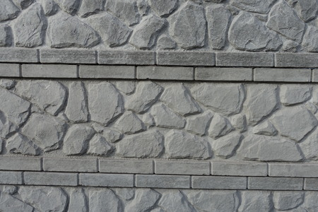 Stone like relief pattern on concrete wall