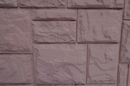 Pink facing tile with stone like texture