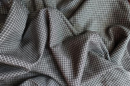 Folded grey viscose fabric with geometric print