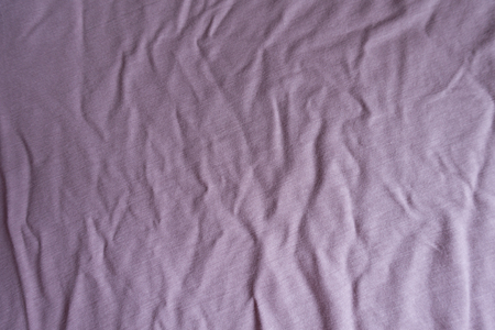 Surface of jammed pink viscose fabric from above
