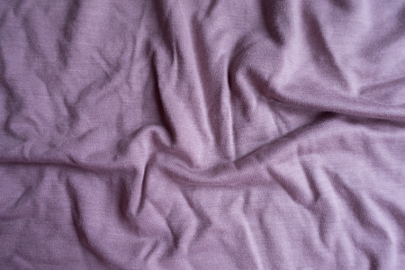 Jammed simple pink viscose fabric from above
