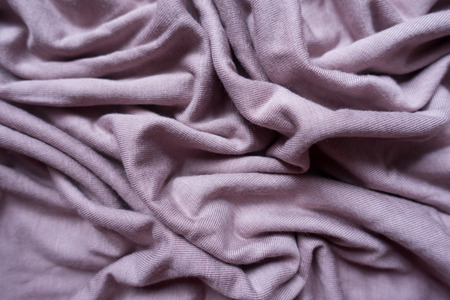Puce fabric with folds from above