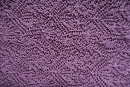 Pink handmade lacy knitting fabric from above Foto de archivo