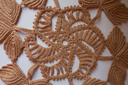 Detail of handmade beige doily from above 写真素材