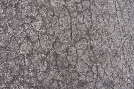 Crackled surface of dusty old concrete road