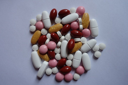 Top view of multivitamins, xylitol, lutein, calcium, menaquinone pills 写真素材
