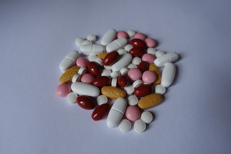 Vitamin K2, multivitamins, xylitol, lutein, calcium pills in a heap 写真素材