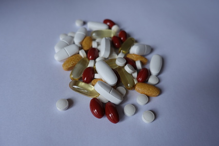Lutein, multivitamins, calcium, vitamin K and fish oil pills 写真素材