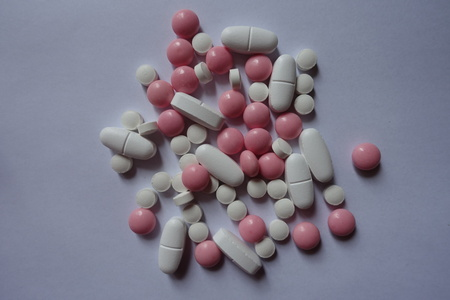 Top view of heap of pink and white pills