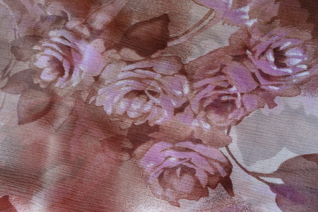 Roses print on dark thin chiffon fabric Stock fotó