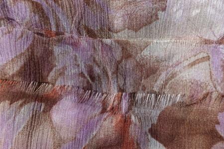 Fraying edge of thin beige chiffon fabric