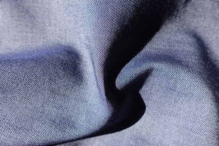 Rippled blue jeans fabric shot with violet Stok Fotoğraf