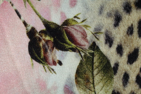 Jersey fabric with rose buds print in subdued colors Stock Photo