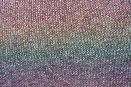 Vertical rainbow gradient on handmade knitted fabric