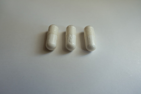 Close shot of three capsules of magnesium citrate