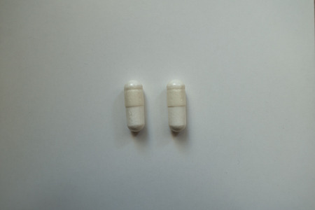White capsules of magnesium citrate (two items) 写真素材