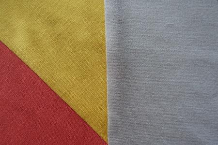 Amber yellow, orange and beige fabrics sewn together Stock Photo